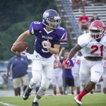 BULLDOG QUARTERBACK hopeful Taylor Lockhart scrambled for running room last Friday night against Henry County.  The evenly matched teams played to a 7-7 tie.  Milan will play at Mayfield, Kentucky this Friday night in preparation for the Aug. 19 opener against Trenton.  Photo by Dale Veazey.