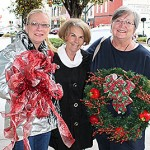 READY FOR CHRISTMAS - Downtown business owners Debbie Brasfield (from left), Lyla Dee Davidson and Debbie Goodrum are gearing up for Friday and Saturday's Christmas Open Houses held around town.