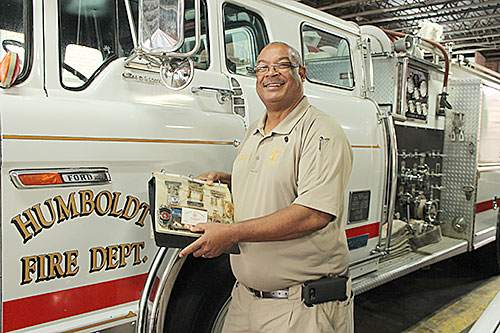 CHIEF IN CHARGE - Last week Humboldt Fire Chief Chester Owens celebrated 40 years on the job as a Humboldt firefighter. Owens was hired by Chief Wayne Day in 1977. In 1994, he was appointed fire chief, a postition he still holds today. Chief Owens holds a folder displaying every badge he has held with the Humboldt fire Department.