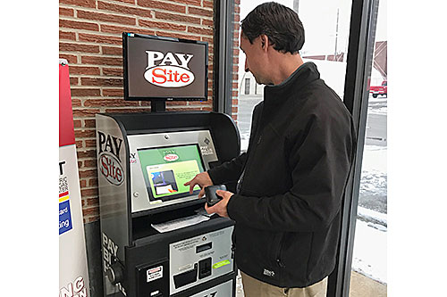 PAYMENT KIOSK - Humboldt Utilities General Manager Alex Smith shows how easy and convenient it is to use the new payment kiosk in the foyer of the office. With the kiosk, customers can pay their utility bill 24 hours a day, seven days a week.