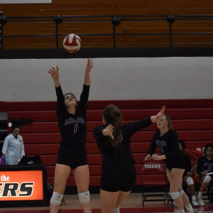 Milan's Kate Parr sets the ball against Sacred Heart in a match at Lexington on Sept. 23, 2021.