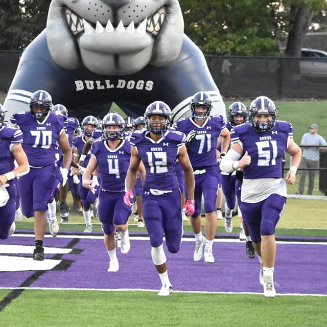 Milan runs out onto the field before playing Liberty during Week 4 of the 2021 high school football season.
