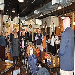 """WARM SMILES AND HOT COFFEE - The Humboldt Chamber held its first Morning Mingle since Feburary. With a slightly smaller crowd those that did attend enjoyed """"mingling"""" with others. A few of those were (center) Kelly Walker catching up with (back facing camera) Amanda Love."""